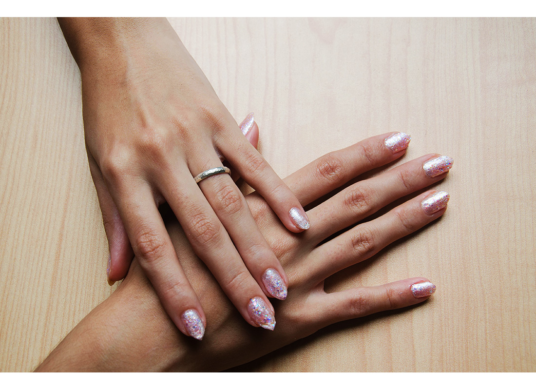 woman's manicured hands