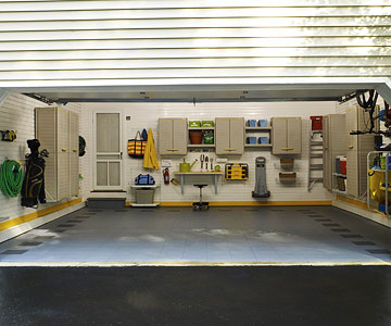 Clean sweep do it yourself strategies from garage storage pros finally the couple signed up for a full scale custom garage renovation complete with hooks racks and cupboards that clip onto paneled walls solutioingenieria Image collections