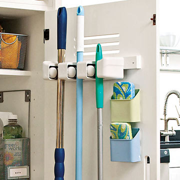 Mount A Snap Lock Grips Organizer On The Back Of Door To Corral Long Handled Tools Like Brooms And Mops