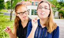 teen girls vaping in high school parking lot