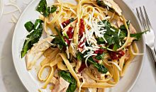 chicken fettuccine on white plat