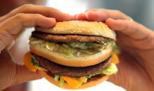 hands holding fast food burger