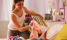 teen girl putting laundry in basket
