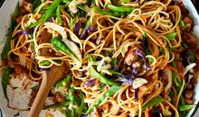 Moo Shu Pork Noodles in bowl with wooden spoon