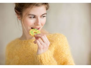 woman eating cookie