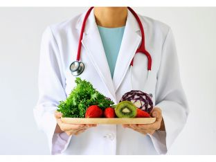 doctor with platter of fruits and veggies