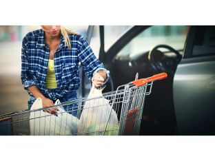 woman loading groceries into car