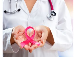 doctor holding pink ribbon for breast cancer awareness