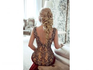 woman with elaborate braid in formal gown