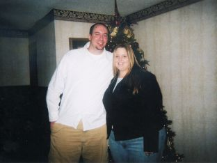Tiffany Howard BEFORE her weight loss, posing in front of Christmas tree with husband
