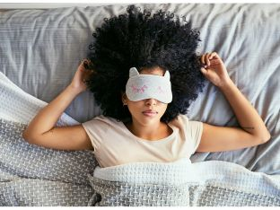 woman asleep wearing eye mask