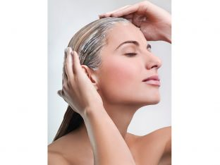 Woman applying hair mask