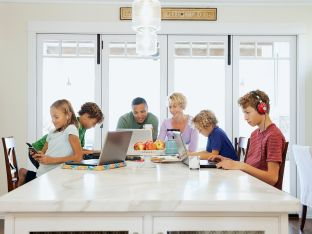 entire family using devices in kitchen
