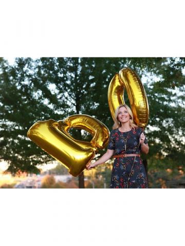 "Amy Reinecke holding ""100"" Balloons"