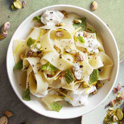 pappardelle with toasted pistachios and mint in white bowl