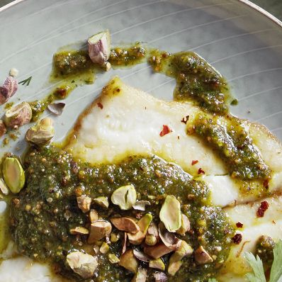 persian pesto with pistachios drizzled on fish