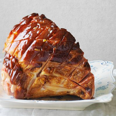 marmalade-glazed ham white plate whole roasted
