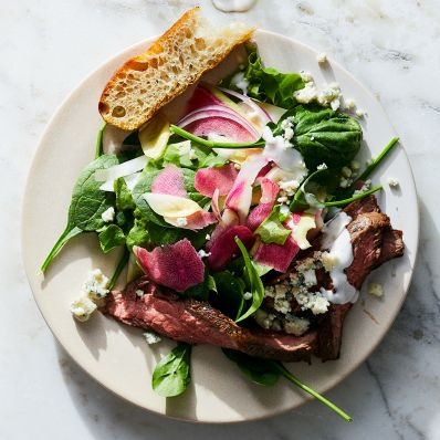 spring salad with steak white plate bread greens