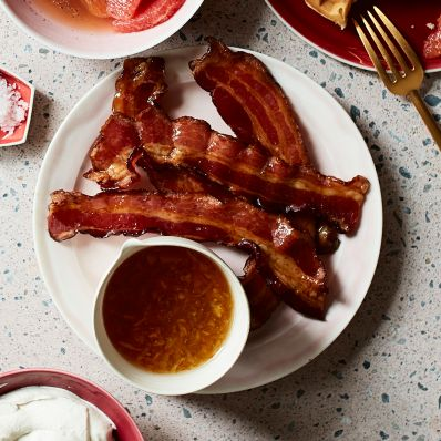 Syrup-Glazed Bacon with marmalade on plate