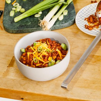 Chipotle Corn Chili with cheese and green onions