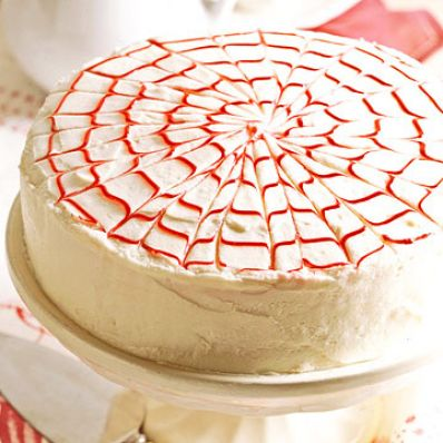 White Cake With Red Feathery Flourish
