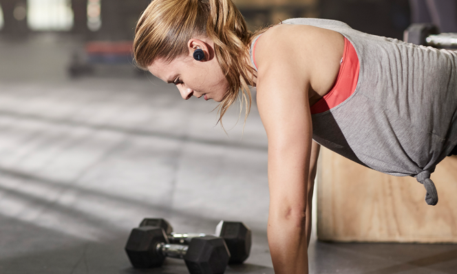 Woman working out wearing Bose SoundSport Free