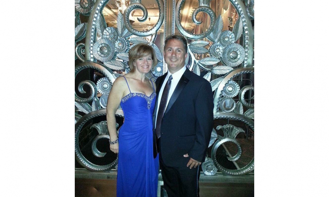 Wendy Rowland and Husband Blue Dress