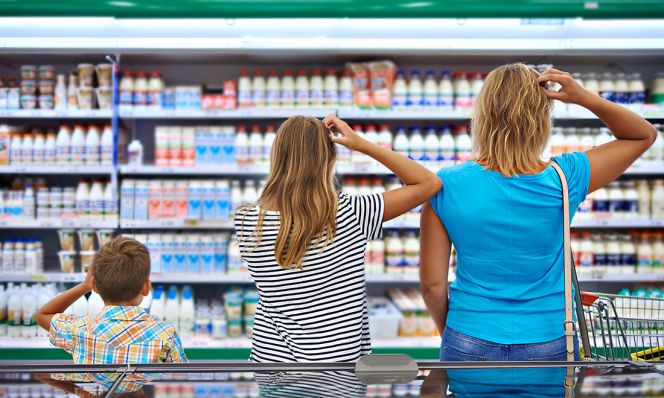 family scratching heads in dairy aisle
