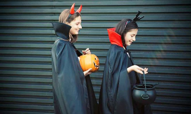 teens trick-or-treating for halloween