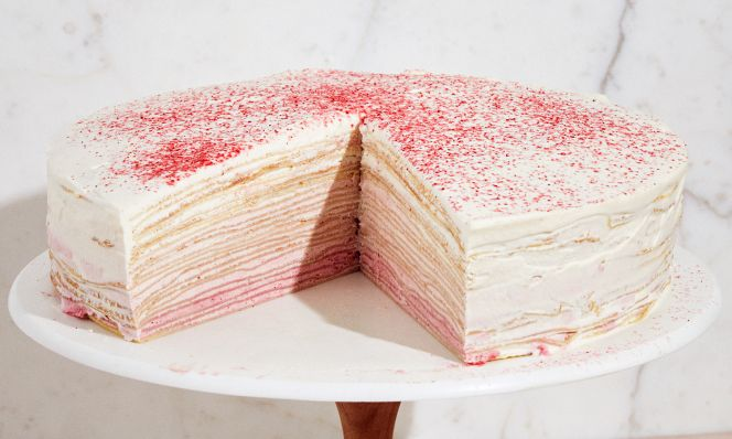 raspberry crepe cake on stand
