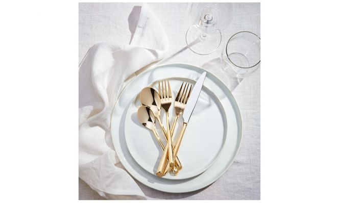 white plates with gold flatware